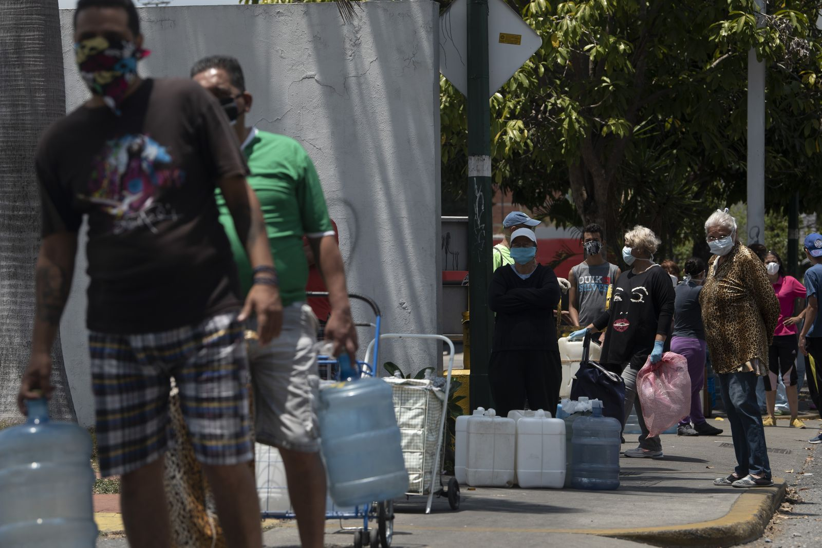 Gas Pumps To Close And People Search For Water Amid Viral Outbreak Growth In Venezuela