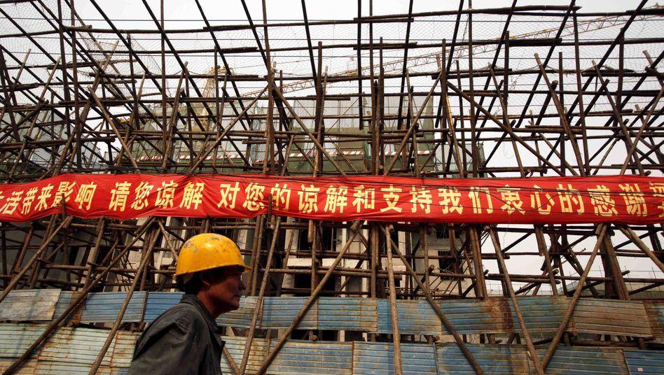 Bauarbeiter in China: Starker Preisverfall auf dem Häusermarkt erwartet