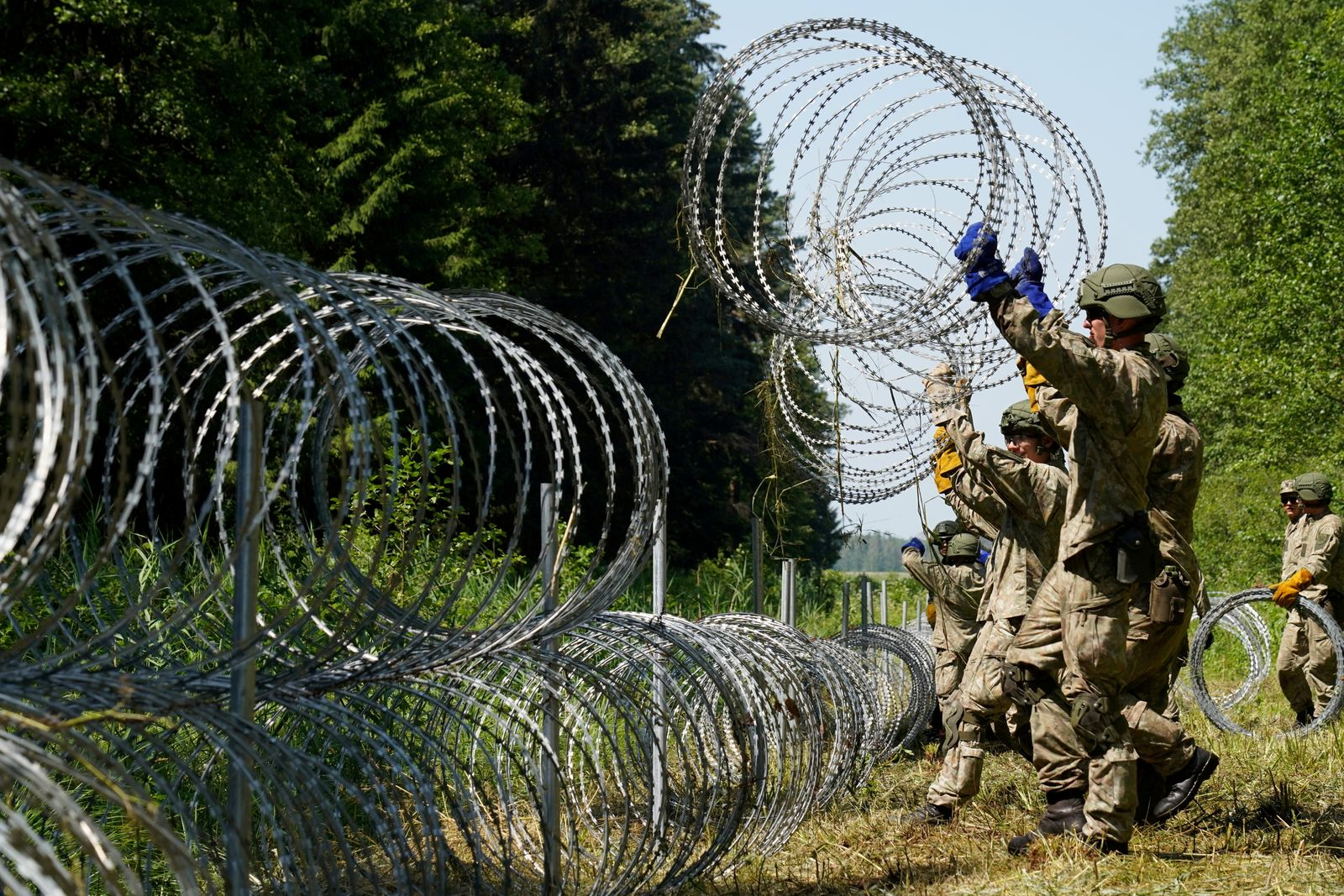 FILE PHOTO: Lithuania toughens Belarus border with razor wire to bar migrants