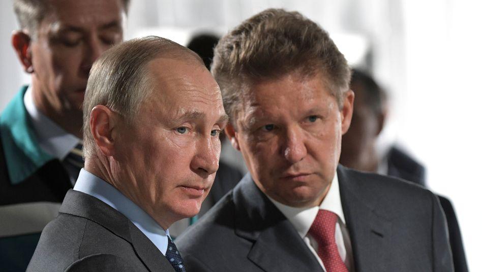 Wladimir Putin und Gazprom-Chef Alexei Miller
