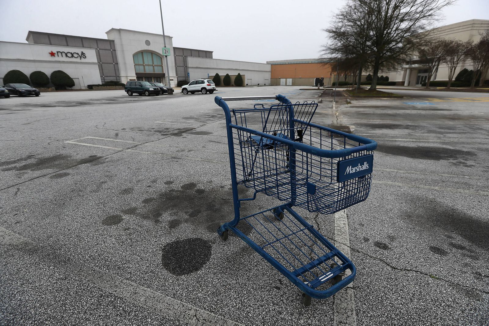 March 17, 2020, Marietta, GA, USA: A few vehicles and an abandoned shopping cart are seen outside one of the entrances t