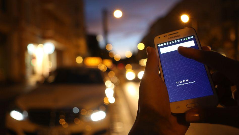 Die Uber-App auf dem Smartphone: Neuanmeldungen mehr als verdoppelt