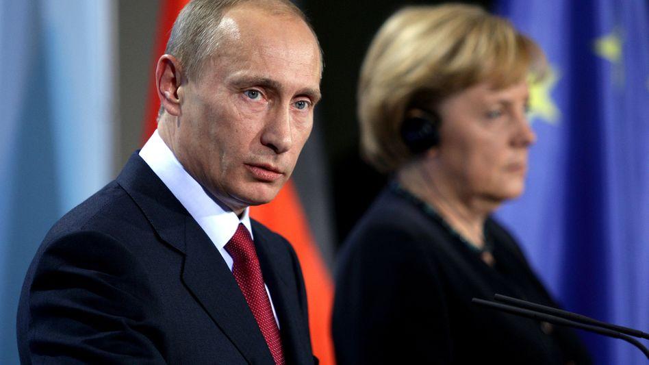 Russlands Präsident Putin, Kanzlerin Merkel: Schwierige Beziehung