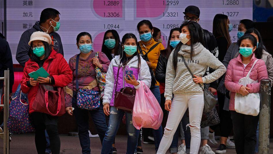 Menschen mit Schutzmaske in Honkong