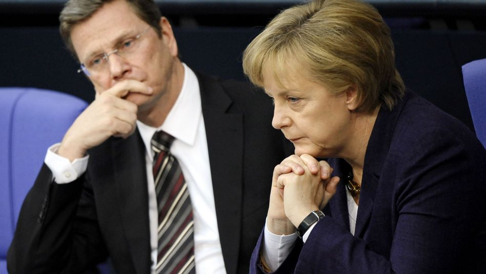 Chancellor Angela Merkel with Foreign Minister Guido Westerwelle on Friday.