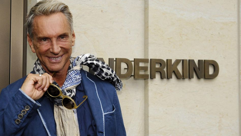 German designer Wolfgang Joop poses in front of his Wunderkind boutique in Berlin.