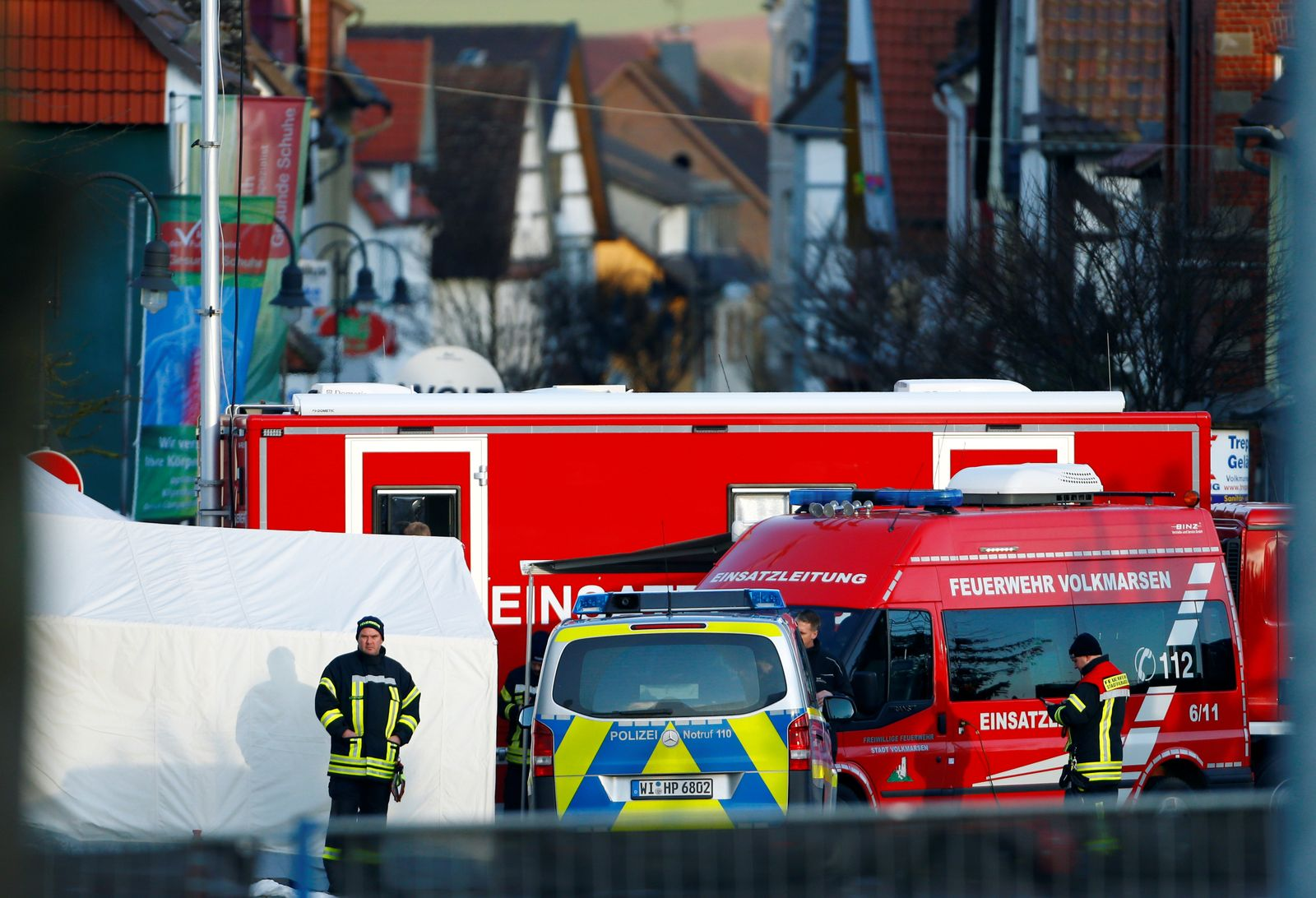 The area is secured by the firefighters and police the day after a car ploughed into a carnival parade injuring several people in Volkmarsen