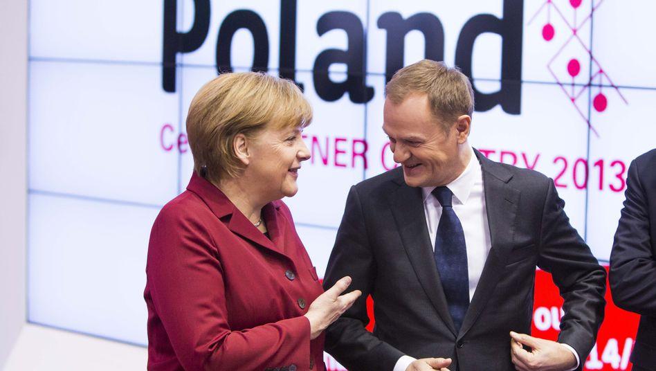Kanzlerin Merkel mit Polens Regierungschef Tusk: Ihr Großvater stammt aus Posen