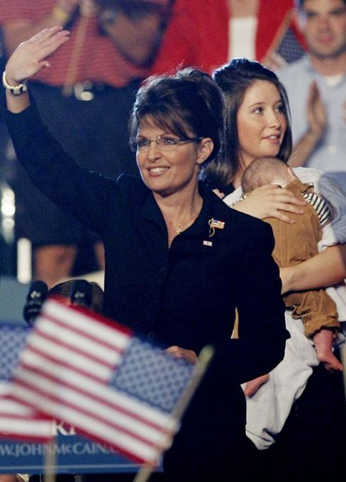 Sarah Palin waves in front of her daughter Bristol and son Trig after being introduced as John McCain's vice-presidential running mate. McCain's campaign announced Monday that 17-year-old Bristol is pregnant.