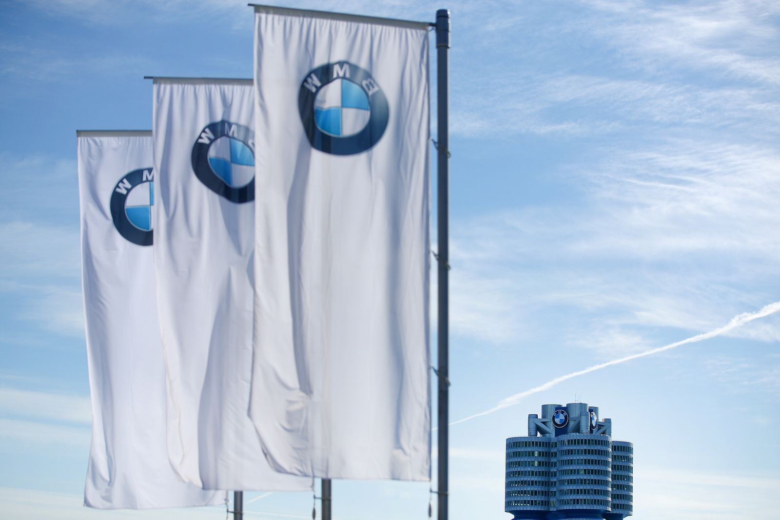 Flags flutter near the headquarters of German luxury carmaker BMW before the company's annual shareholder meeting in Munich