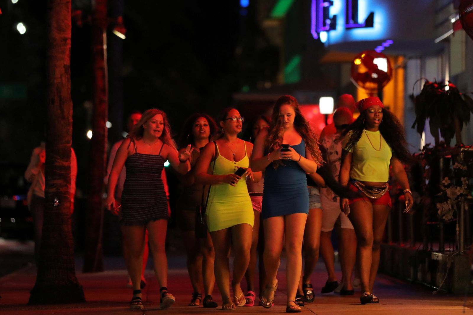 University students walk along a street of Miami Beach during Spring Break