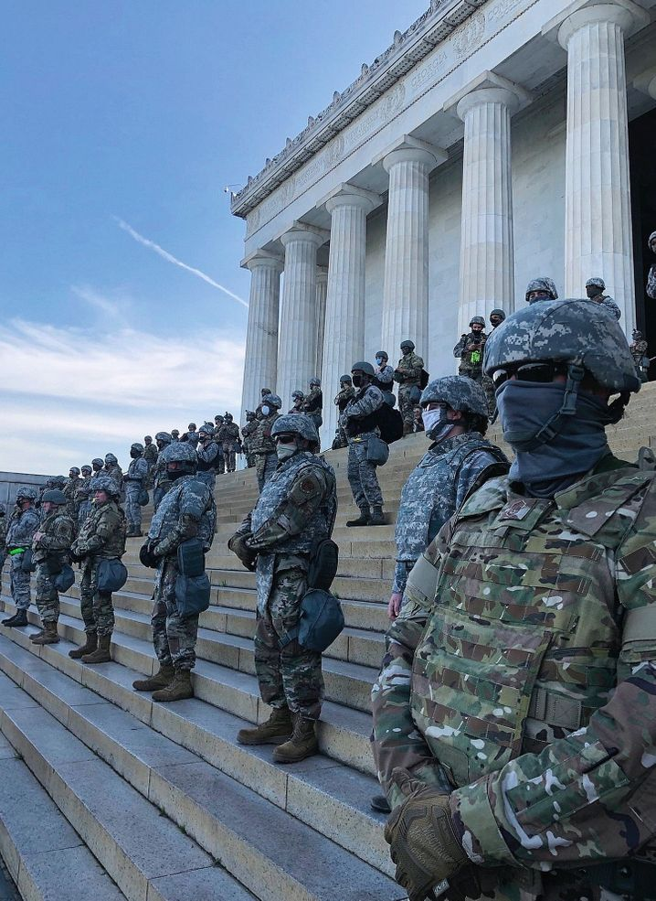 Troops from the National Guard standing on the steps of the Lincoln Memorial in Washington, D.C.
