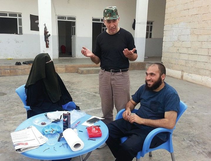Father S. (middle) in Syria