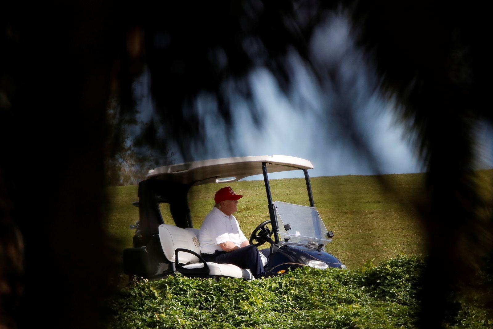 U.S. President Donald Trump plays golf at the Trump International Golf Club in West Palm Beach