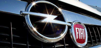 Logos von Fiat und Opel: Übernahme-Initiative aus Detroit