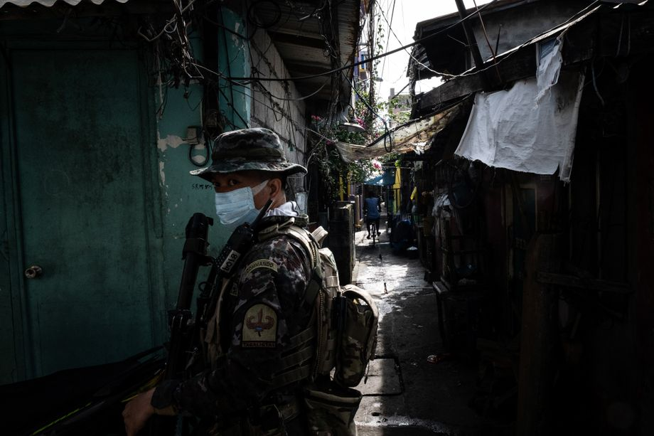 Security personnel patrolling the streets of Navotas City, in northern Manila