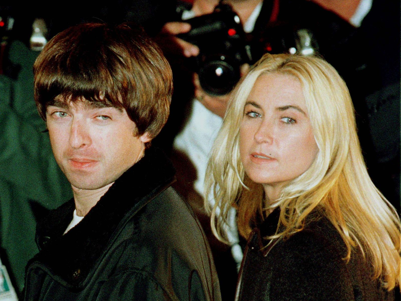 Oasis guitarist Noel Gallagher and his girlfriend Meg Matthews arrive for the grand opening of the F..