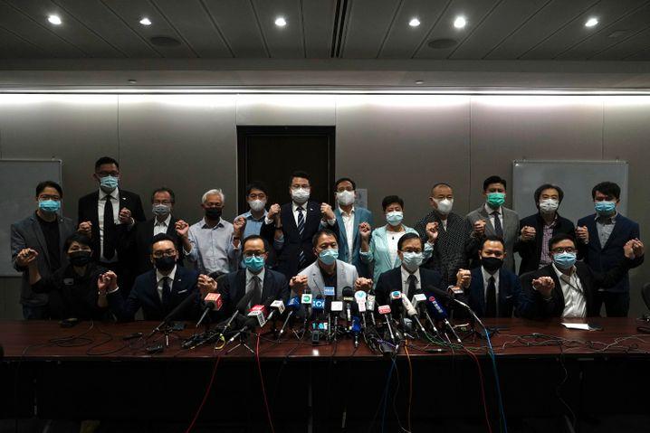 Stehen seit Jahren unter politischem Druck aus Peking: Demokratieaktivisten und Politiker in Hongkong