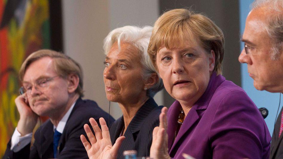 Weltbank-Präsident Zoellick, IWF-Chefin Lagarde, Kanzlerin Merkel: Lieber Banken retten als Staaten?