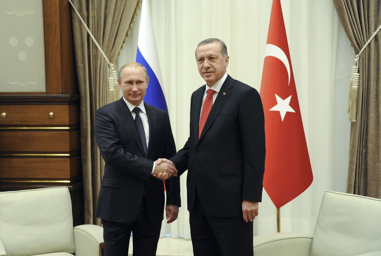 Russia's President Vladimir Putin shakes hands with his Turkish counterpart Tayyip Erdogan during a meeting at the Presidential Palace in Ankara