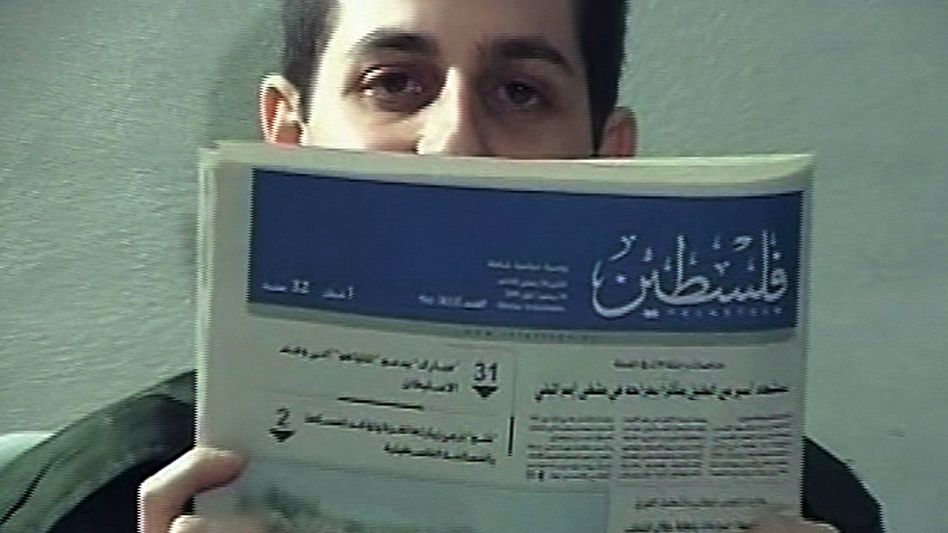 Hamas released a video to Israel showing Galid Shalit with a recent newspaper to prove that he is alive and in good health.