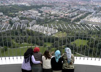 Turkish women who have fled their husbands and violent marriages and live in a shelter take a stroll in Munich's Olympic Park. The women, activists say, live in constant fear that their husbands or families will find them and abuse or kill them.