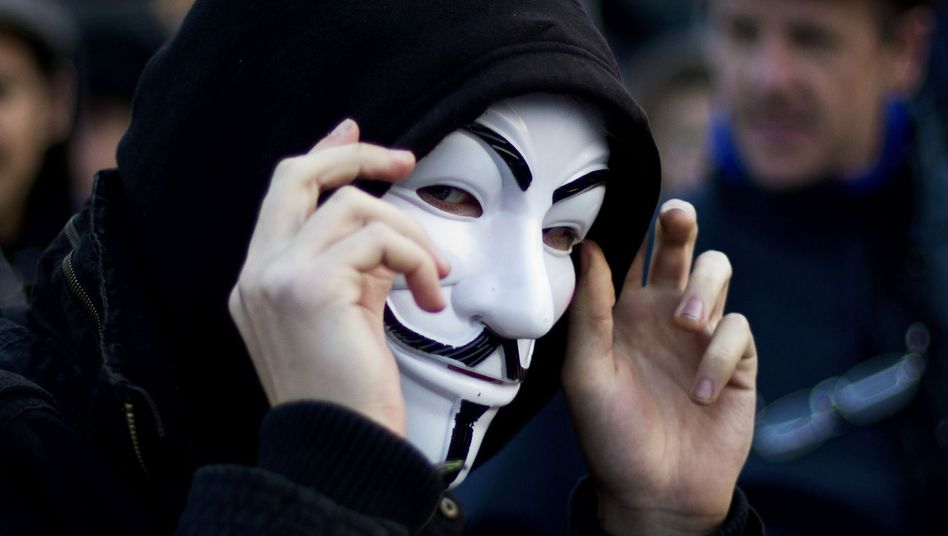 An Anonymous activist at a demonstration in Berlin: The Guy Fawkes mask is the movement's trademark.