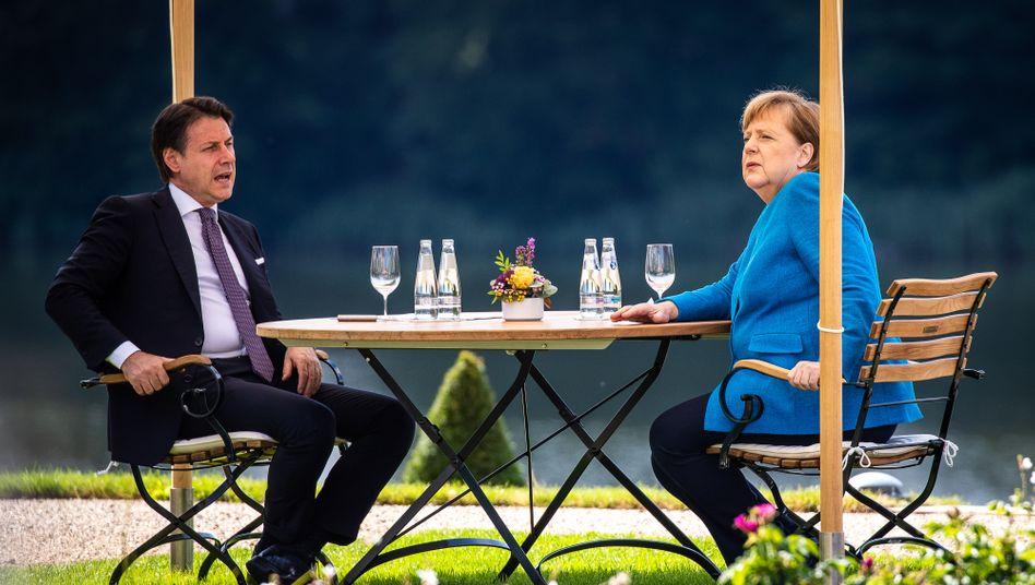 Bundeskanzlerin Angela Merkel und Italiens Ministerpräsident Giuseppe Conte auf Schloss Meseberg