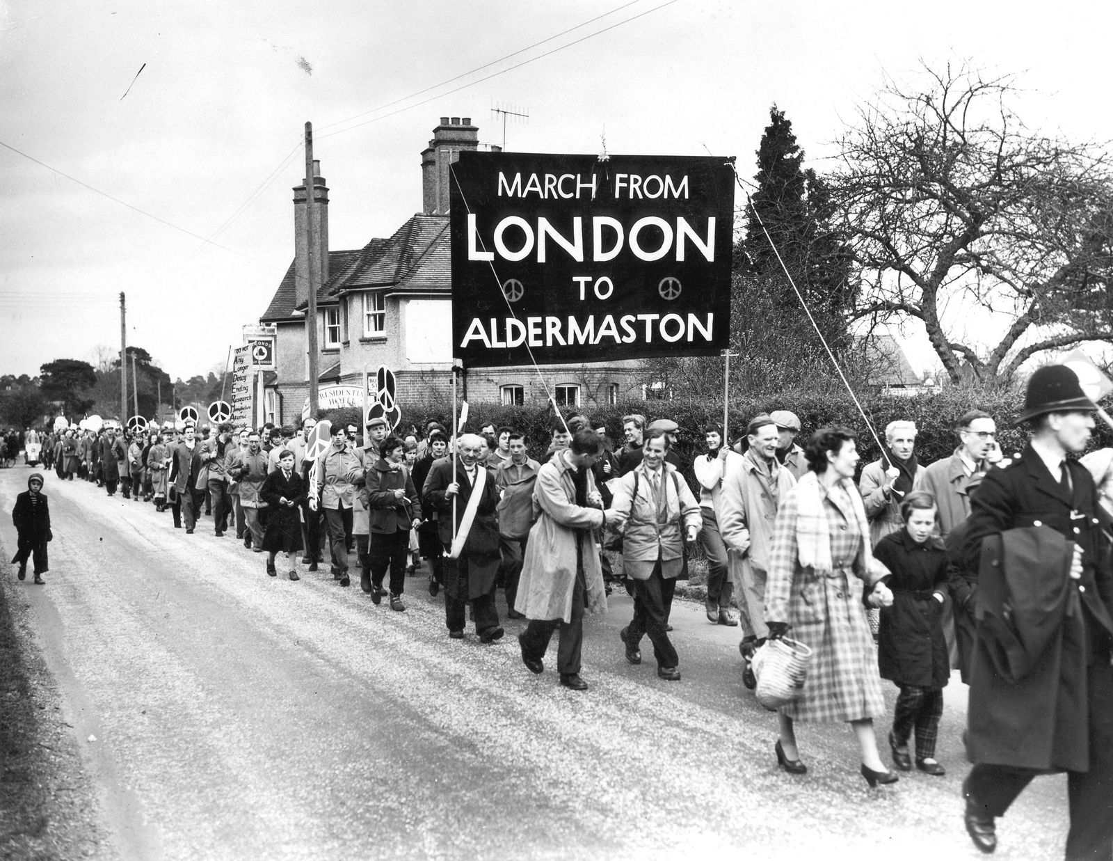 The mile long procession of marchers arriving at Aldermaston at the end of their trek from London. The march was a pacifist anti H-Bomb protest in a bid to stop the event of nuclear war. 8th April 1958