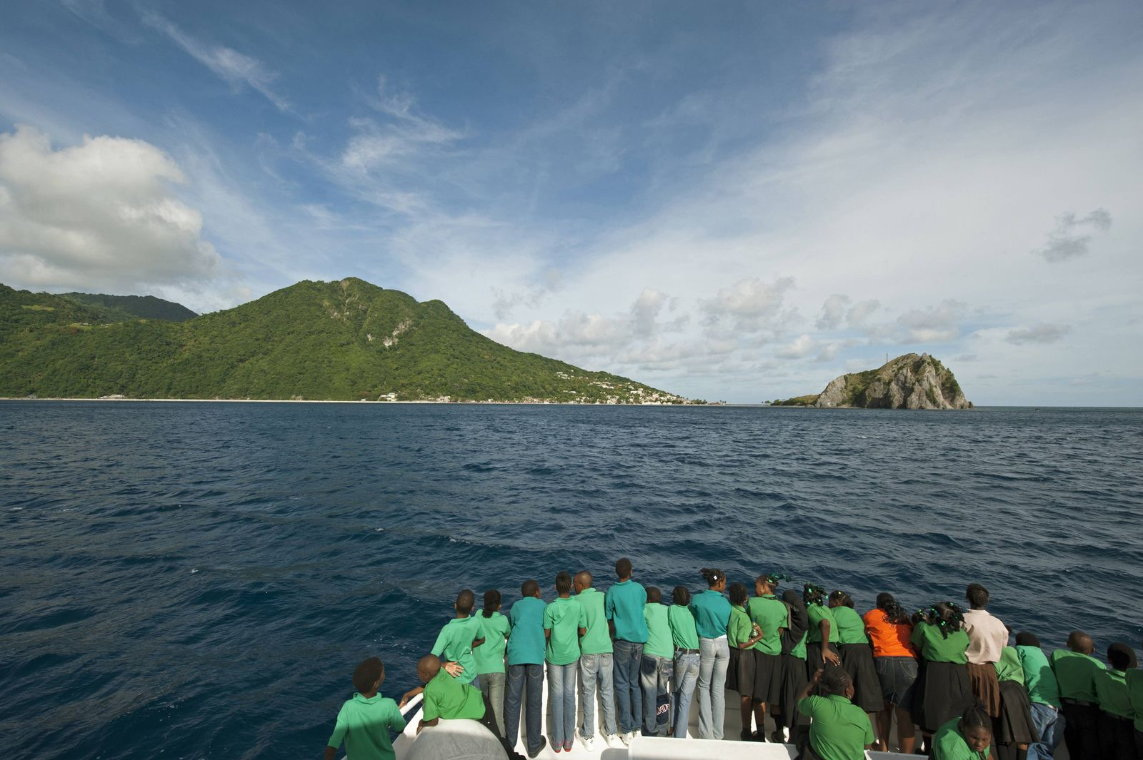 Dominica Roseau schoolchildren looking for dolphins and whales on the boat during the Unicef Dom