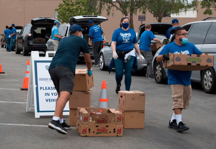 "Volunteers distributing food to the needy in California: ""There are fewer marriages in the white working class, fewer people going to church, fewer people with stable home lives and a lessened sense of community. That puts these people at great risk."""
