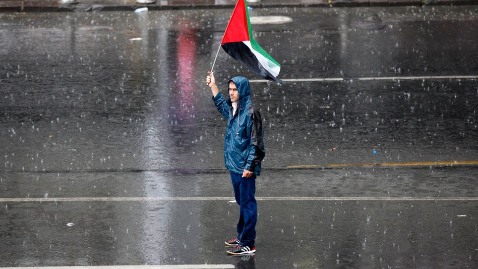 A Turkish demonstrator in Ankara holds up a Palestinian flag during an anti-Israeli march.