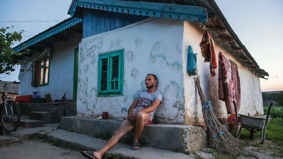 """Seasonal worker George Mitache in front of his home in the Romanian village of Băcani: """"We were basically locked away."""""""