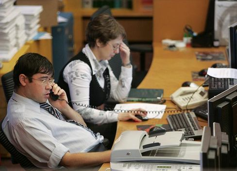 Traders work in the Moscow Interbank Currency Exchange (MICEX) in Moscow.