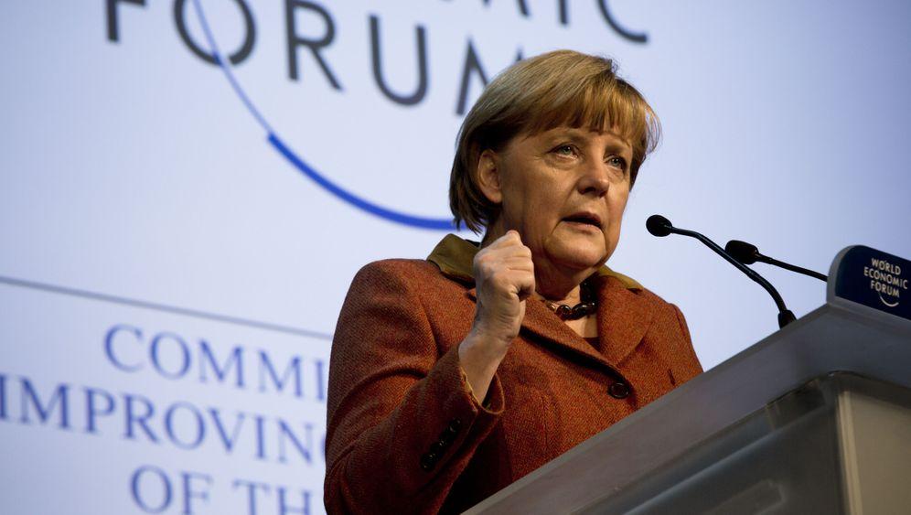 Begegnung in Davos: Merkel bremst Cameron aus