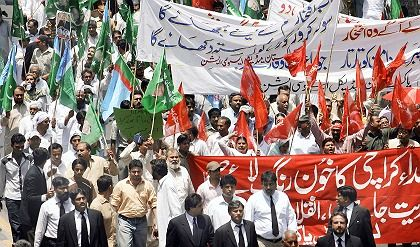 Government opponents march in Lahore.