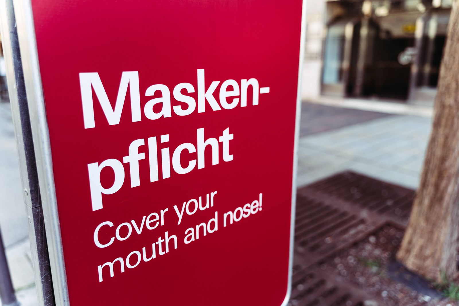 Augsburg, Bavaria, Germany - 27 april 2021: Maskenpflicht cover mouth and nose - sign in the pedestrian zone in the city