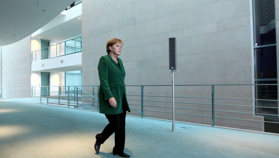 Angela Merkel im Kanzleramt: Gleich drei Sorgen auf einmal