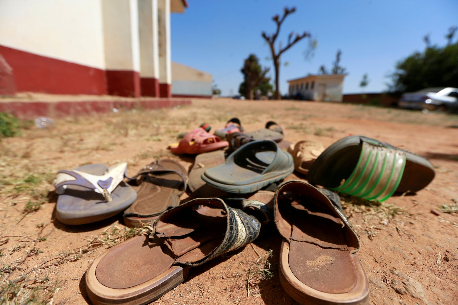 FILE PHOTO: A collection of student footwears left behind after gunmen abducted students at the Government Science school in Kankara