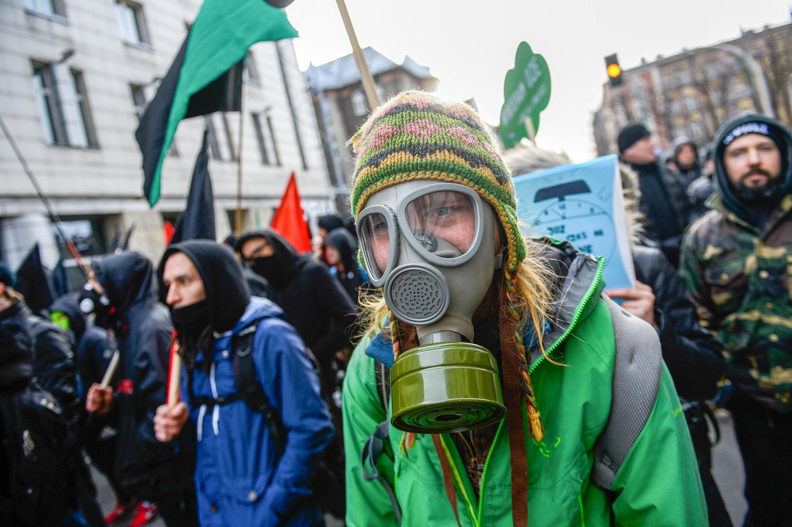 A woman seen using a gas mask during the March. March for