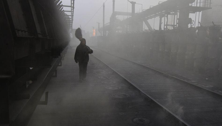 Arbeiter in chinesischer Fabrik: Peking will offenbar im Klimaschutz voranschreiten