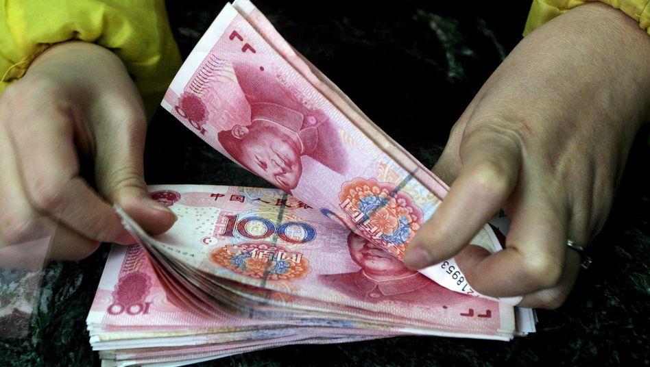Yuan-Scheine: Vor dem Neujahrsfest heben Chinesen verstärkt Bargeld ab