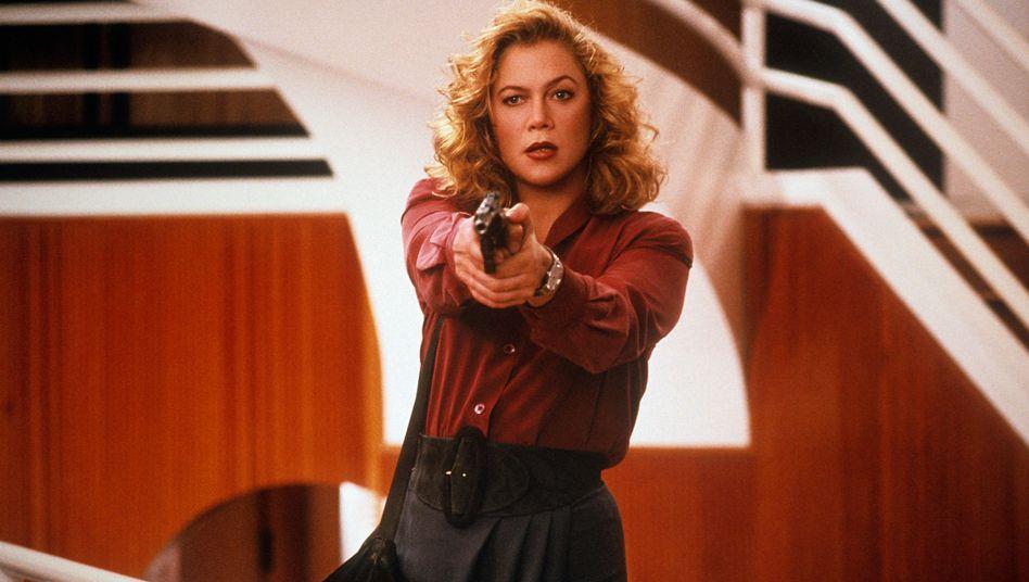 Kathleen Turner als V.I. Warshawski im gleichnamigen Film von 1991