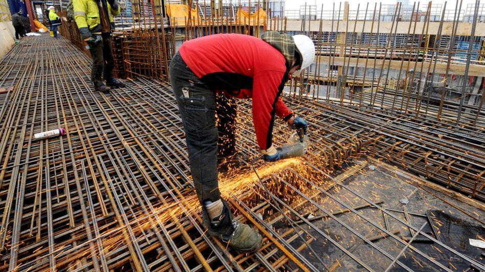 Bauarbeiter in Hamburg: Deutschland könnte die Weltkonjunktur stabilisieren