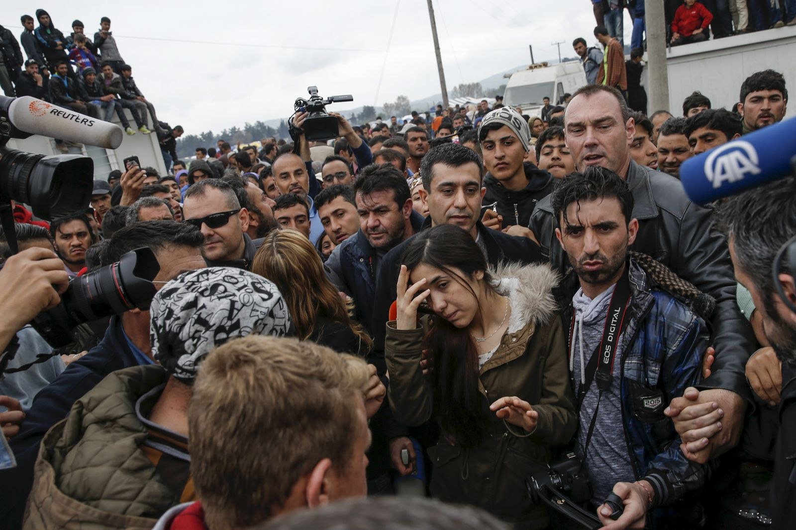 Taha, an Iraqi woman of the Yazidi faith who was abducted and held by the Islamic State for three months, walks through a makeshift camp for migrants and refugees at the Greek-Macedonian border near the village of Idomeni