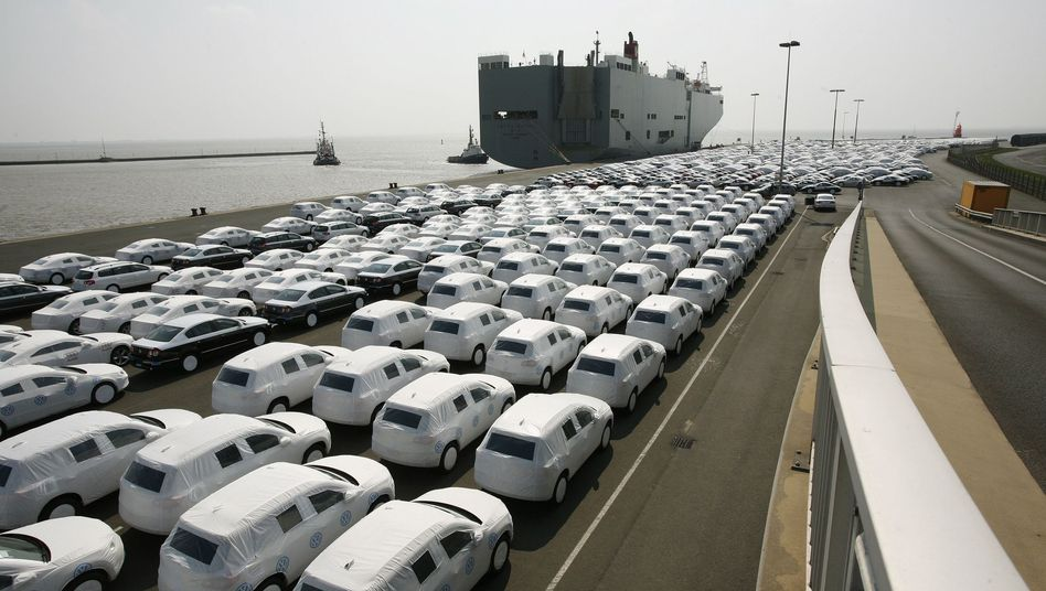Volkswagen cars are covered with protective covers before they are loaded for export. Germany's trade surplus has skyrocketed beyond that of China.