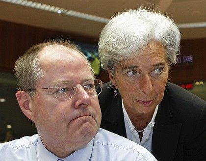 Germany's Finance Minister Peer Steinbrück (L) and his French counterpart Christine Lagarde look glum ahead of the EU finance ministers meeting on Tuesday.