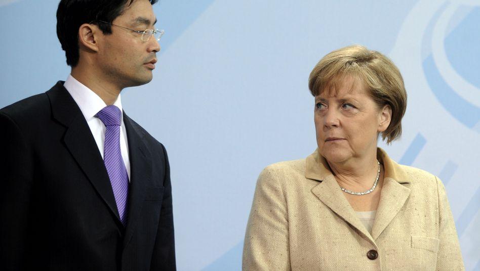 FDP-Chef Rösler, Kanzlerin Merkel: Der Vizekanzler will nicht nur nett sein
