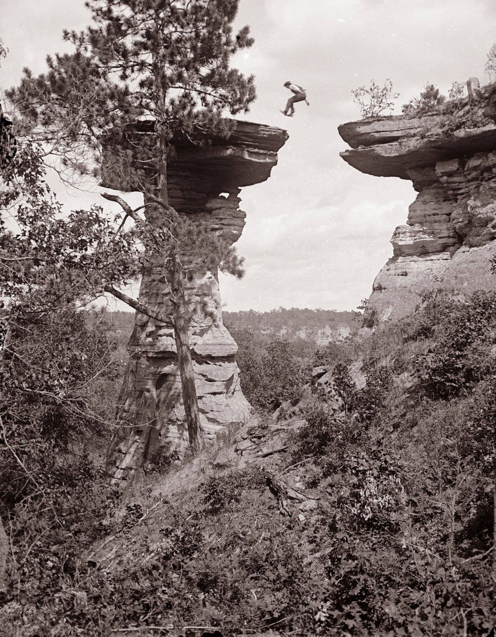 Man Leaping to Stand Rock