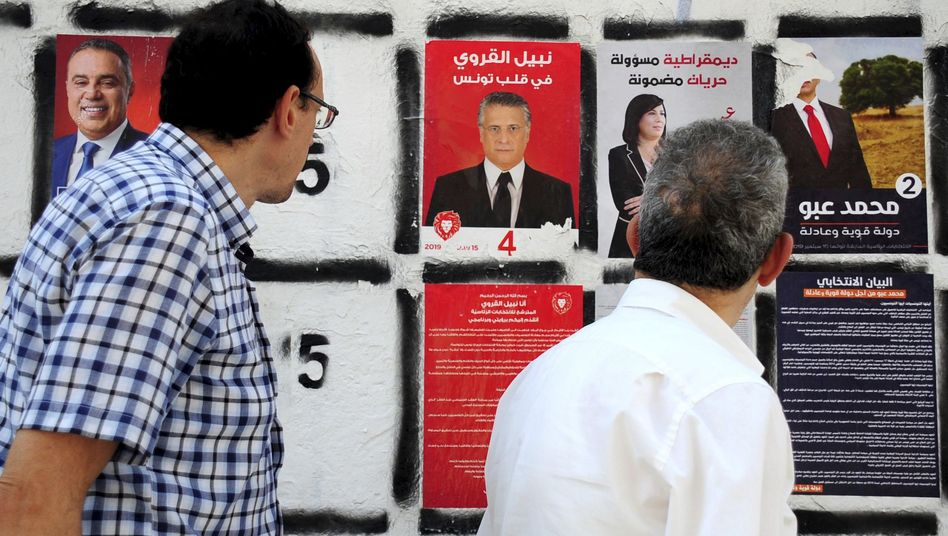 Wahlplakat von Nabil Karoui (mit der Nummer 4): Ein Populist will Präsident werden